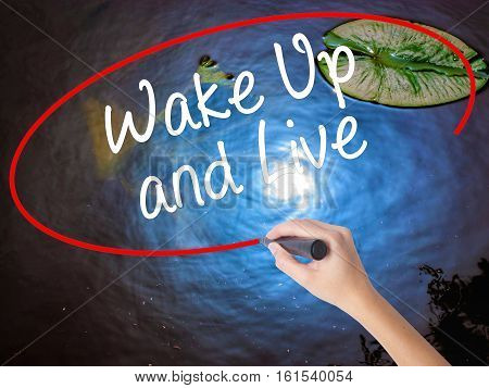 Woman Hand Writing Wake Up And Live With Marker Over Transparent Board.