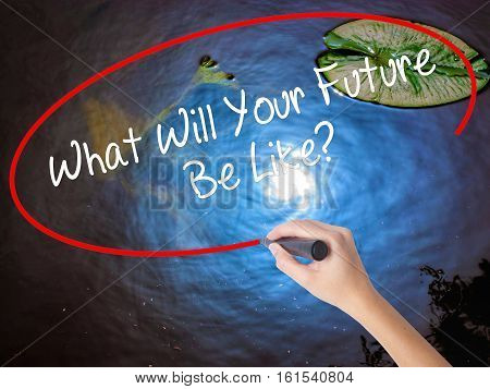 Woman Hand Writing What Will Your Future Be Like? With Marker Over Transparent Board