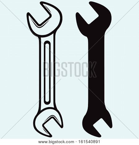Wrench icon. Isolated on blue background. Vector silhouettes
