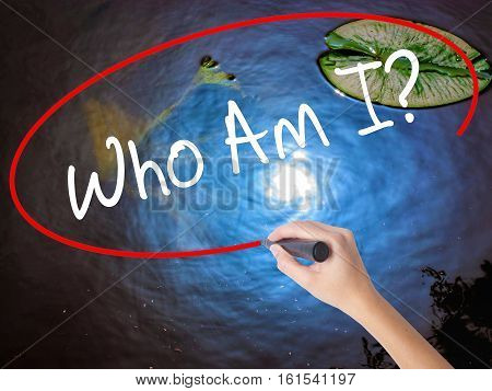 Woman Hand Writing Who Am I? With Marker Over Transparent Board