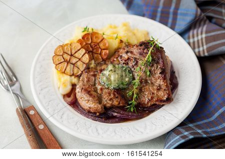 Fried Pork With Herb Butter And Mashed Potatoes