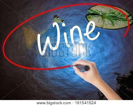 Woman Hand Writing Wine  With Marker Over Transparent Board