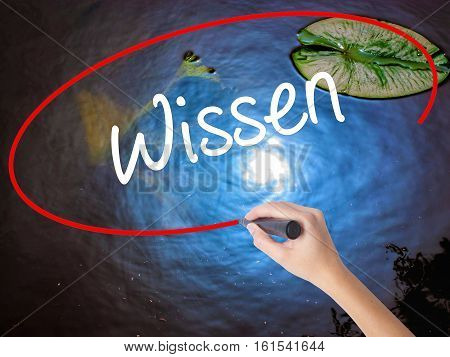 Woman Hand Writing Wissen (know In German)  With Marker Over Transparent Board