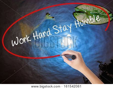 Woman Hand Writing Work Hard Stay Humble  With Marker Over Transparent Board