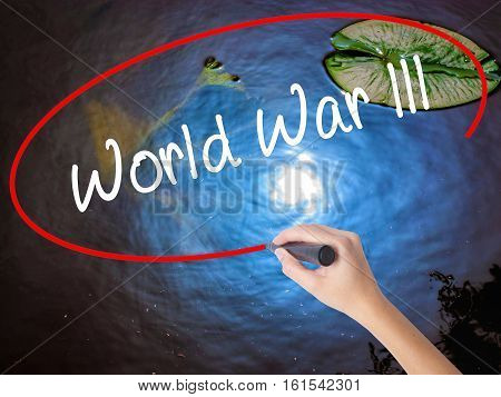 Woman Hand Writing World War Lll With Marker Over Transparent Board