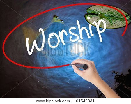 Woman Hand Writing Worship With Marker Over Transparent Board