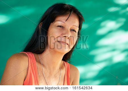 Cuban people and emotions portrait of latina lady smiling and looking at camera. Happy hispanic woman from Havana Cuba smiling.