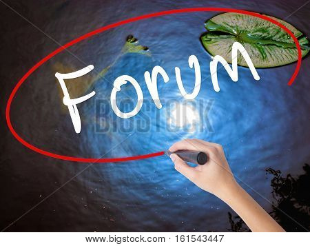 Woman Hand Writing Forum Marker Over Transparent Board