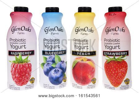 ALAMEDA CA - JANUARY 14 2016: four 32 fluid ounce bottles of Glen Oaks Farms probiotic drinkable low fat yogurt. Raspberry Blueberry Peach and Strawberry bottles side by side on white background