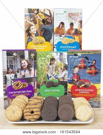 ALAMEDA CA - FEBRUARY 09 2016: Boxes of the five original Girl Scout cookies produced by ABC Bakers with all cookie varieties on a plate in front of the boxes on light wood table