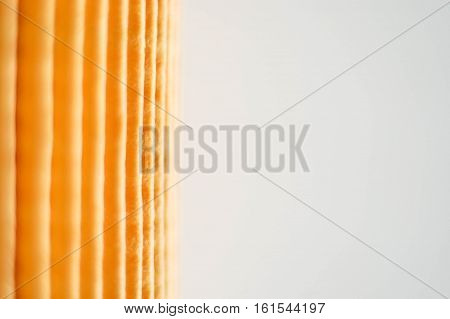 Yellow paper Oil filter texture on white background