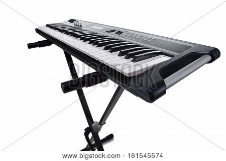 Isolated synthesizer on the rack on white background
