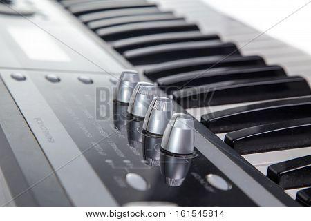 Keyboard of musical synthesizer on white background