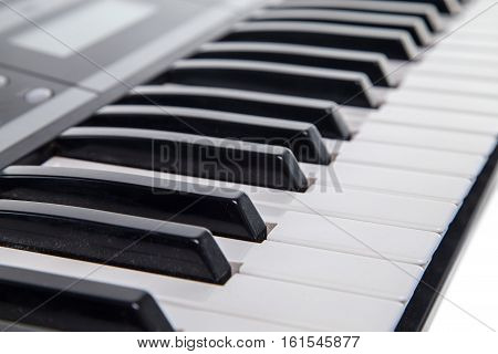 Keyboard of musical synth on white background