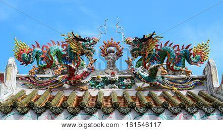 Dragon Statue Under Blue Dragon Sky