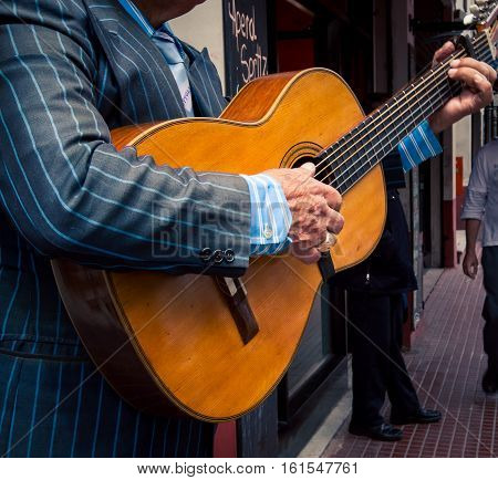 Street performer playing guitar in Buenos aires