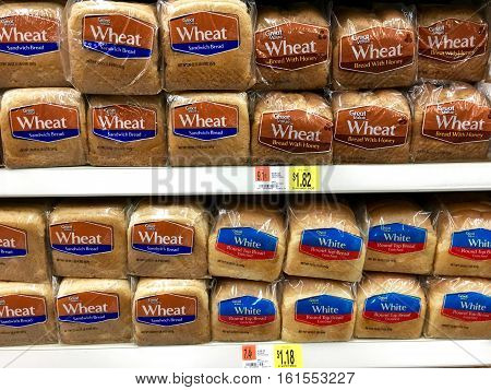 San Leandro CA - April 08 2016: Great Value wheat bread wheat bread with honey and white bread on a grocery store display. Generic brand with lower price than the competition
