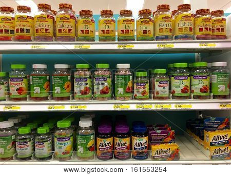 Alameda CA - April 08 2016: Store shelf display multiple brands variety vitamins and supplements in chewable gummy form. Gummy vitamins made for adults are widely available in many different brands.