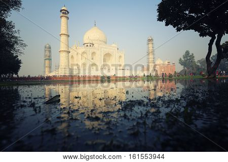 Agra, India - January 25, 2016: Amazing Taj Mahal with some tourist around in Agra in India.