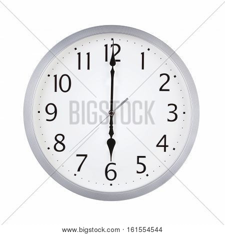Six o'clock on the round clock dial