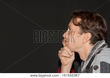 Young Man Portrait In Profile On Dark Background