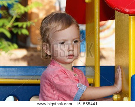 Little children activities story of family games. Child playing outside on playground