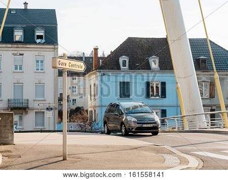 MULHOUSE FRANCE - DEC 19 2015: Gare Centrale - Central Train station street arrow street sign seen in central French town at major intersection with French architecture homes behind