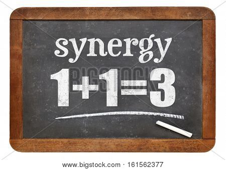 synergy concept on a slate blackboard, isolated on white