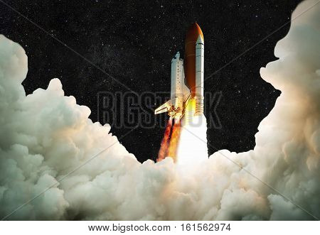 Spaceship Takes Off Into Space. Rocket Flies On A Background Of The Starry Sky