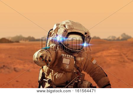 Spaceman Walks On The Red Planet Mars. Space Mission. Astronaut Travel In Space