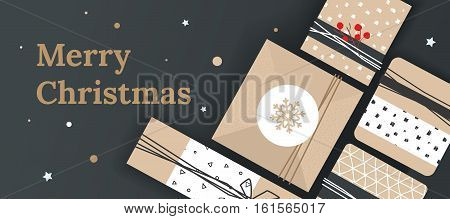Christmas banner for the store. The poster with presents and space for text. Festive box on the table, top view.