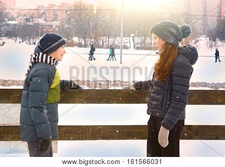 Moscow, Russia, December 9, 2016: Unidentified kids in warm winter clothes boy and girl on open air ice rink close up photo faving fun in park on weekend in Moscow, December 9, 2016.