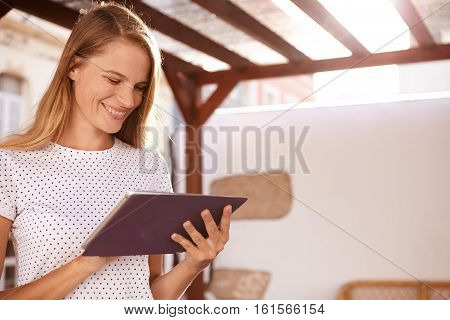 Happy Blond Girl Smiling At Touchpad