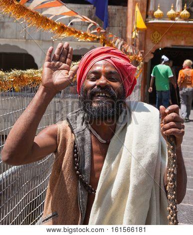 MANIKARAN, INDIA. 4 June 2009:  Closeup portrait of  Hindu pilgrim coming out of a Vishnu Temple.   Manikaran is a sacred pilgrimage centre for Sikhs, district Kullu in Himachal Pradesh, India, located in the Northern part of Kullu valley.