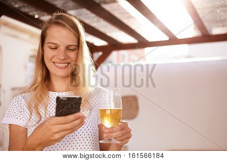 Smiling Blond With A Cellphone And Beer