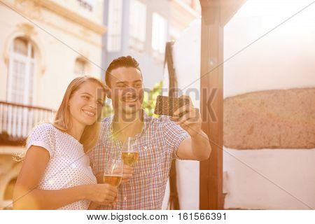 Happily Smiling Couple Posing For Selfie