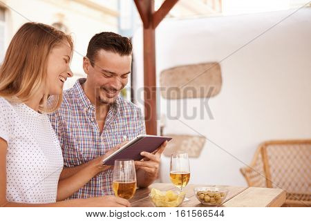 Happy Young Couple Using A Touchpad