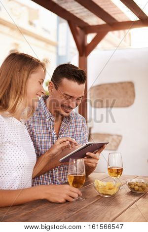 Happy Millennial Couple Sharing A Touchpad