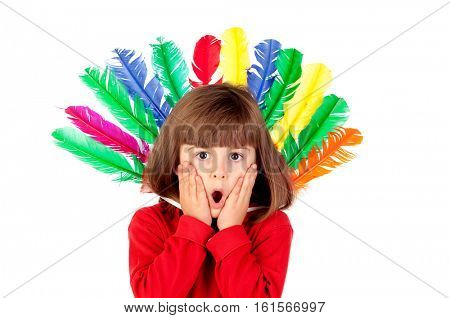Surprised girl with colorfully feathers isolated on a white background
