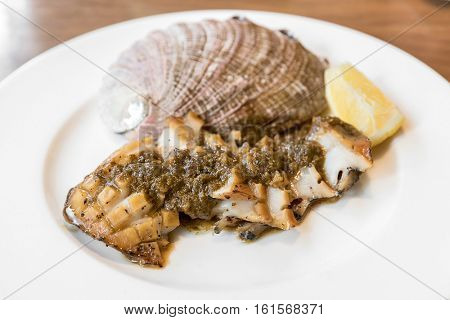 grilled Japanese Abalone steak with lemon
