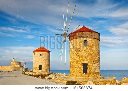 Windmills and fort of St. Nicholas in town of Rhodes.
