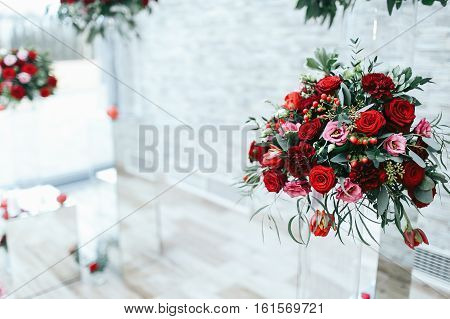 Red Bouquet Of Roses, Peonies And Ranunculus Stands On The Glass Box