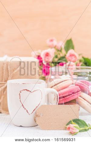 Morning coffee with flowers and macaroons. Mather's day, Valentine's concept. Copy space