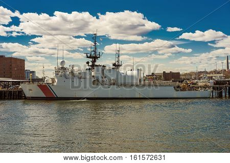 Boston, USA - April 28, 2015: White ship moored in the bay in the center of Boston USA. The city is surrounded by water and is one of the oldest cities in the United States. The water transport is very common there.