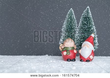 Mr. & Mrs. Santa Claus in the forest to choose the tree