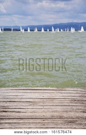 Closeup of the wooden dock with water surface