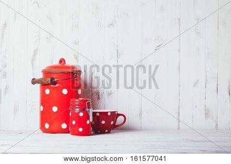 Red polka dot vintage kitchen utensils on a white talbe