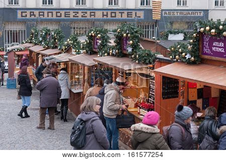 Brno,Czech Republic-December 5, 2016: People browsing market stalls at Christmas market on the Cabbage Market on December 5, 2016 Brno Czech Republic