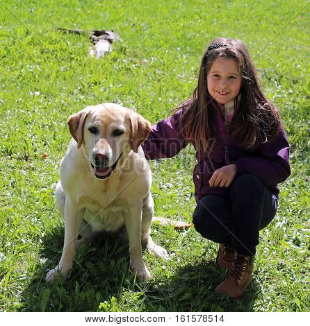 Little Girl With Labrador Retriever Dog