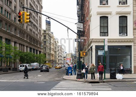 NEW YORK - MAY 2 2016: Ordinary street scene in Manhattan with unknown people in front of a pedestrian crossing